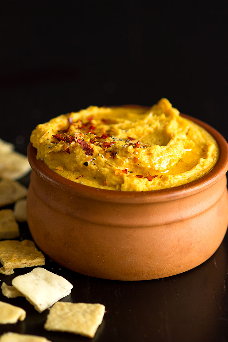 Turmeric Sweet Potato Hummus | Baked sweet potato with cannelini beans, tahini, garlic and spices to make the most delicious creamy dip, perfect to serve during a autumn dinner party!